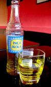 Inca_kola_bottle_and_glass_2